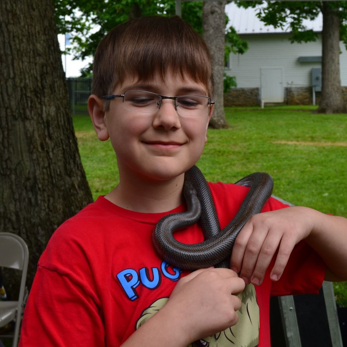 Fun Zone, Critters and Conservation, boy with snake